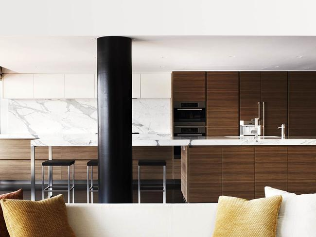 John McGrath's luxury loft apartment in Walsh Bay. Behind the living area, a new Poliform kitchen with marble benchtops.