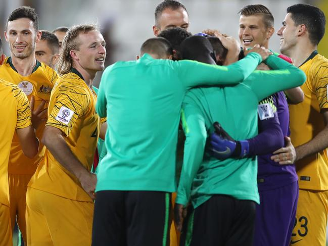 The Socceroos engulf Mat Ryan after the penalty shootout win over Uzbekistan. Francois Nel/Getty Images