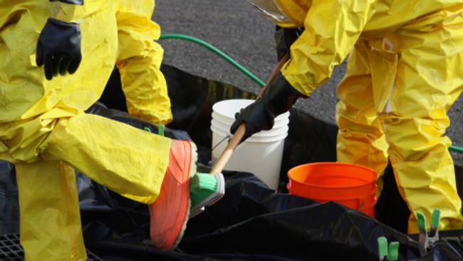 Hazmat team members clean up after a chemical attack.