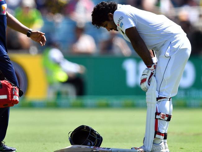 Kusal Perera after being hit on the helmet by Jhye Richardson. Saeed Khan/AFP)