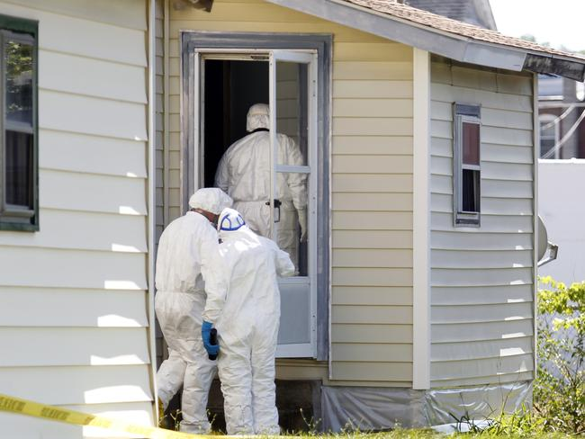 Ashland Police Department and Ohio BCI execute a search warrant on a home where a woman had been abducted. Picture: AP