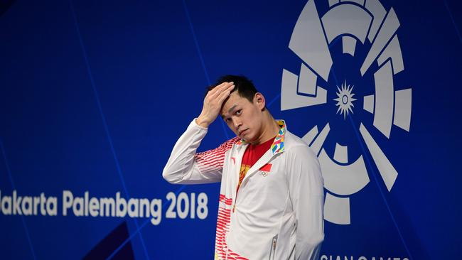Sun Yang celebrates during the victory ceremony for the men's 1500m freestyle swimming event during the 2018 Asian Games in Jakarta.