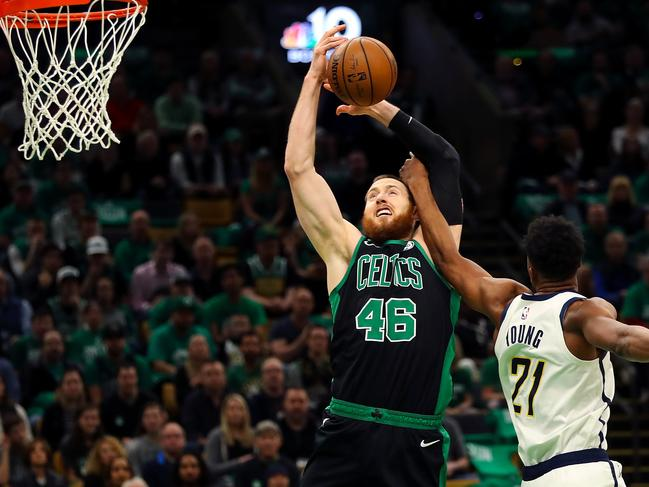 Thaddeus Young fouls Aron Baynes. Picture: Adam Glanzman/Getty Images/AFP