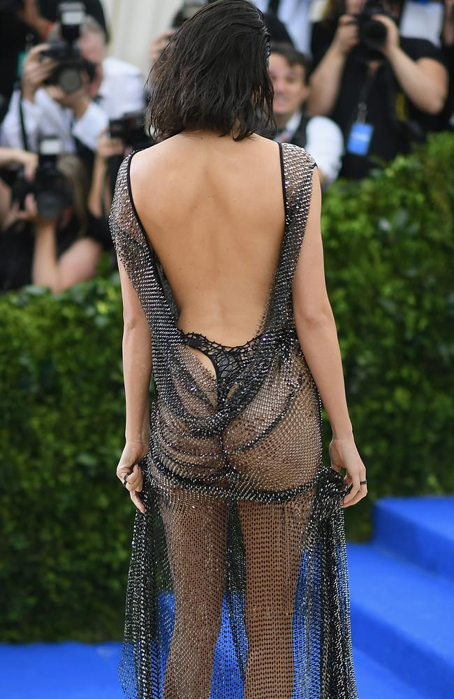 Her black G-string was clearly visible underneath.