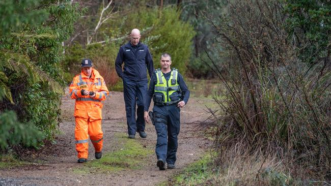 Police and SES workers were going property to property in Marysville and surrounds, searching backyards for the missing student. Picture: Jason Edwards
