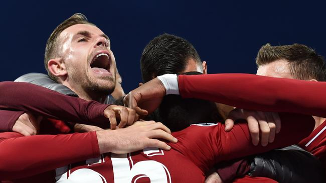 LIverpool player Jordan Henderson and teammates celebrate reaching the Champions League final with a semi-final win over Barcelona at Anfield. Picture: Paul Ellis/AFP