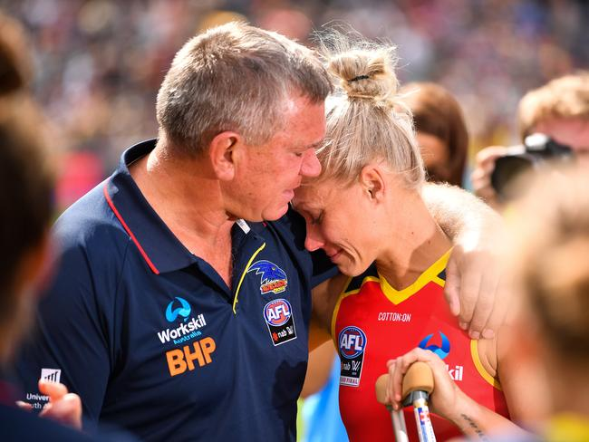 Erin Phillips is consoled by dad Greg after he injury.