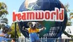 GOLD COAST, AUSTRALIA - SEPTEMBER 16: Patrons pose for a photo at the entrance of Dreamworld on September 16, 2020 in Gold Coast, Australia. Dreamworld and its sister park White Water World have reopened to the public after the theme parks were closed in March over coronavirus concerns. Under the park's new COVID-19 safe plan, visitor numbers have been reduced and some rides and attractions will remain closed. Visitors will need to maintain physical distancing from other guests, and additional handwashing and hand sanitiser stations have been installed throughout the park. (Photo by Quinn Rooney/Getty Images)