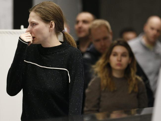 Relatives and friends of victims react at Sheremetyevo airport in Moscow where at least 40 people died when an Aeroflot airliner burst into flames. Picture: AP Photo