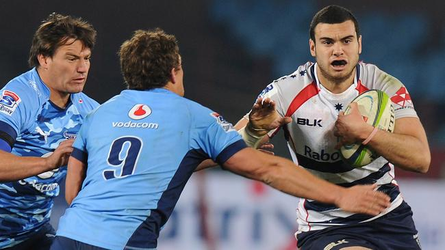 Jack Debreczeni of Rebels battles for the ball with Piet van Zyl and Jacques Louis Potgieter.