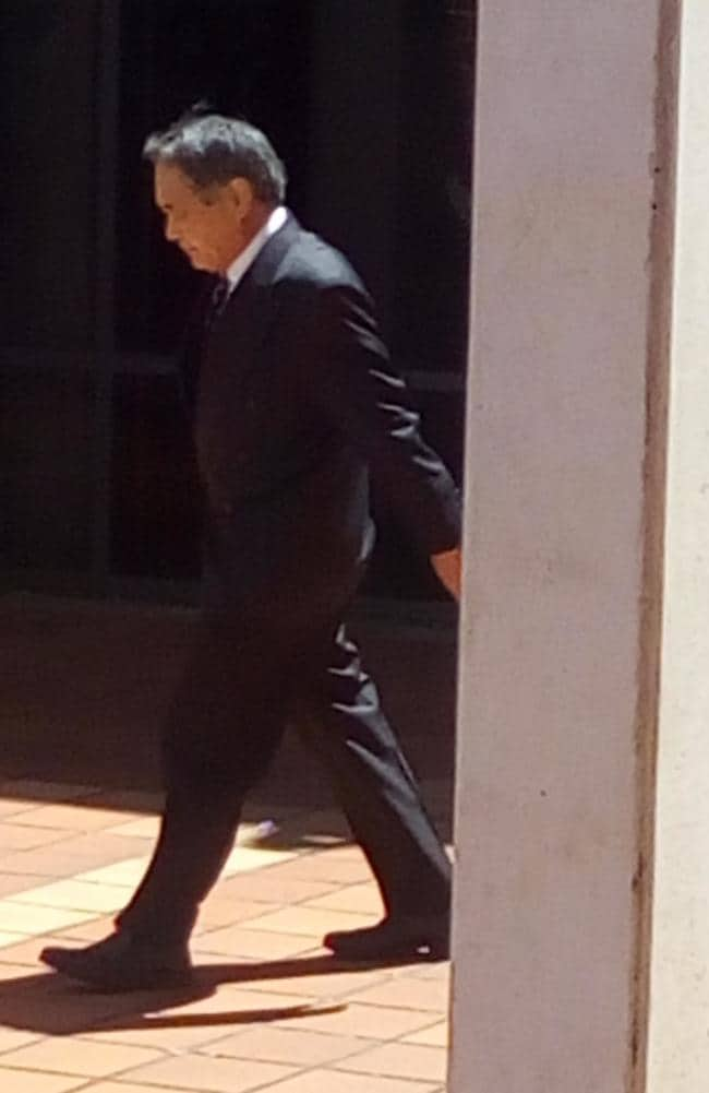 Masaaki Imaeda ducking out of Campbelltown Court on Thursday after applying for a community order instead of two years' prison. Picture: Candace Sutton.