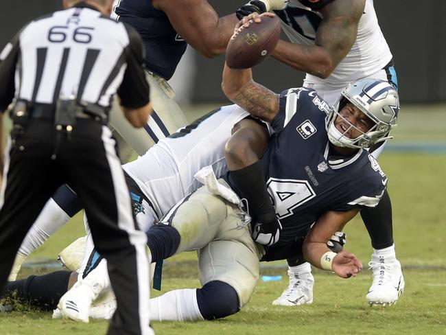 Dallas Cowboys' quarterback Dak Prescott (4) is sacked by Carolina Panthers' Kawann Short. Picture: AP