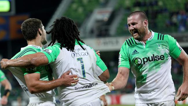 Loose-head prop Aki Seiuli (centre) is congratulated by teammates after scoring the first of two tries.
