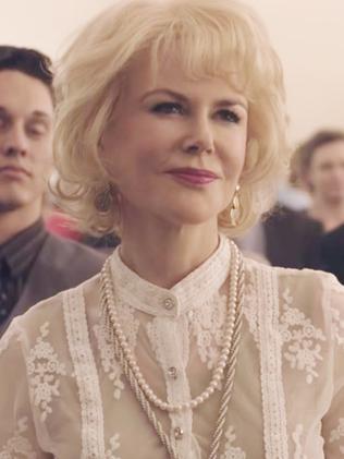 A bewigged Nicole Kidman.