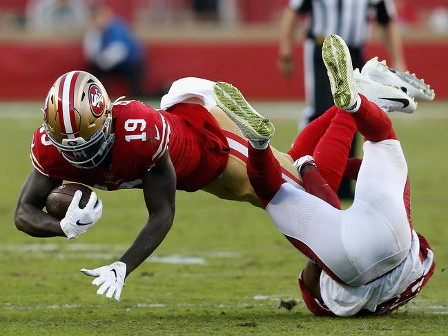 Wide receiver Deebo Samuel of the San Francisco 49ers dives with the football after a reception against safety Jalen Thompson of the Arizona Cardinals during the first half of at Levi's Stadium in Santa Clara, California. Picture: Lachlan Cunningham/Getty Images
