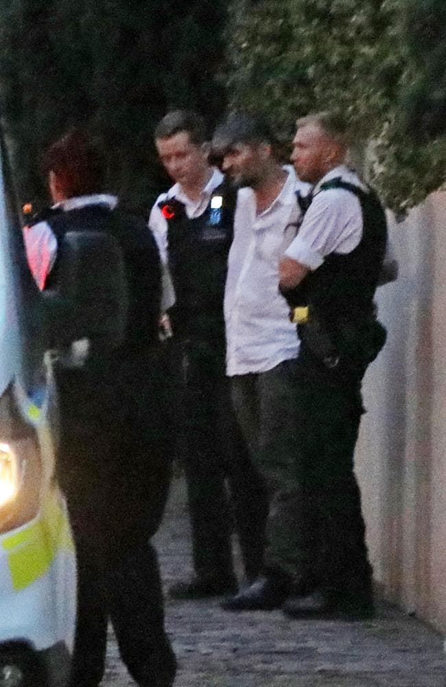 George Michael's ex Fadi Fawaz is arrested and put in police van at 'the squat.' Picture: Mega