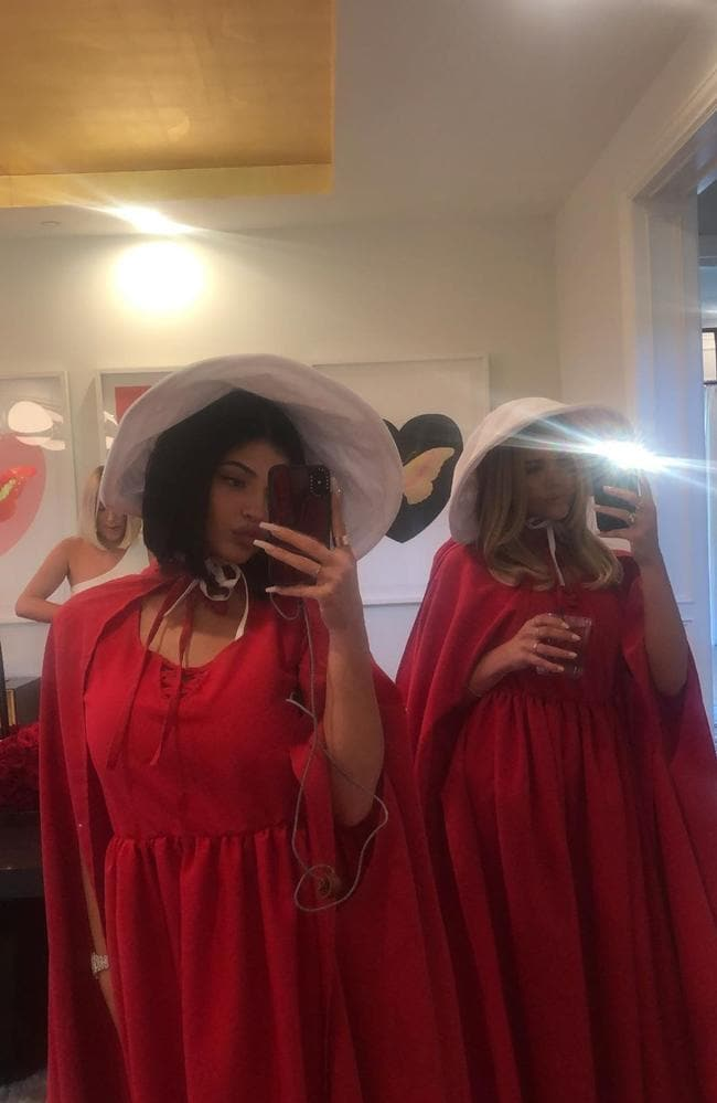 Kylie Jenner (left) in her Handmaid's Tale outfit.