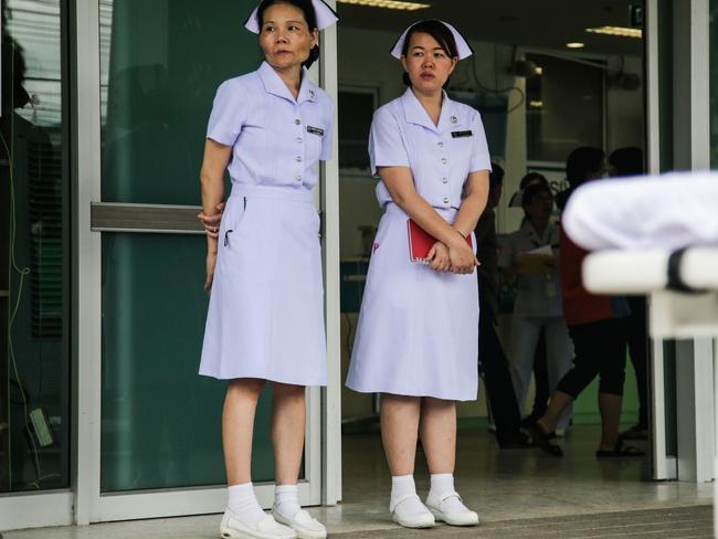 Nurses wait for the boys outside the Chaing Rai Prachanukroh Hospital. Picture: Lauren DeCicca/Getty Images