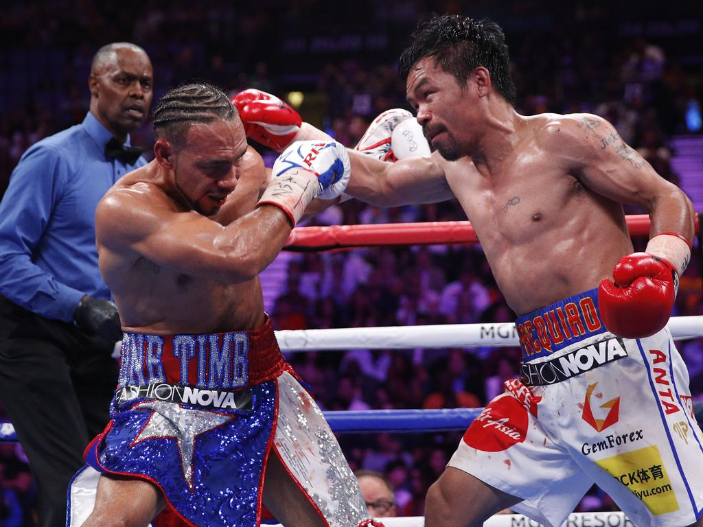 Manny Pacquiao, right, and Keith Thurman exchange punches in the seventh round during a welterweight title fight Saturday, July 20, 2019, in Las Vegas. (AP Photo/John Locher)