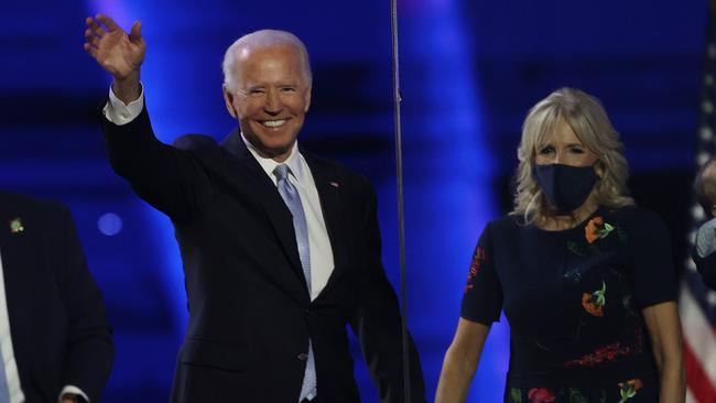 President-elect Joe Biden – pictured with wife Jill – has vowed to unify the bitterly divided country. Picture: Tasos Katopodis/Getty Images/AFP