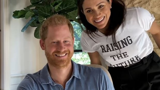 During the documentary, Meghan Markle was seen looking over Prince Harry's shoulder. Picture: Supplied