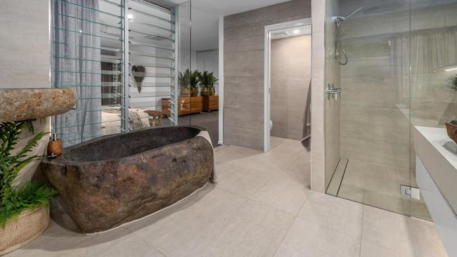 The riverstone bath is one of the home's many highlights.