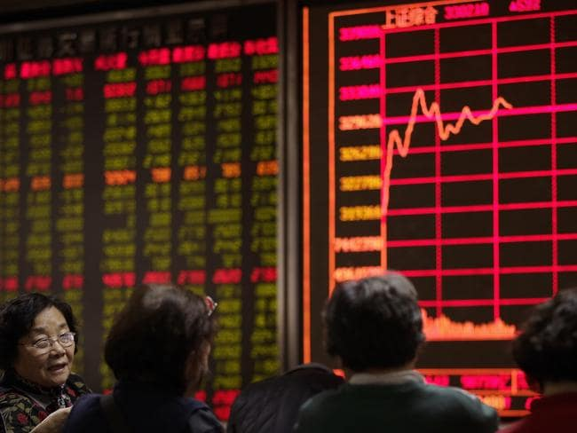 Took a dive ... Trading on the Shanghai and Shenzhen stock exchanges in China was frozen for the day after shares tumbled more than seven per cent. Picture: AP/Andy Wong