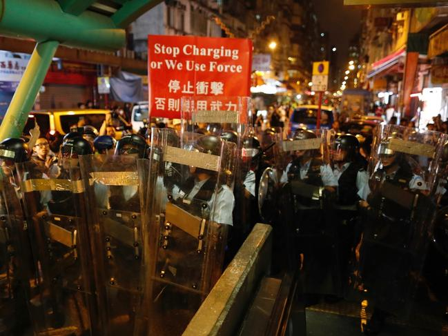 Police move out from the Shum Shui Po police station to confront protesters in Hong Kong on Wednesday. Picture: AP