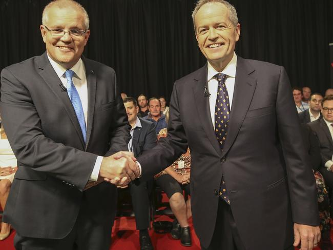 The two leaders beamed as they shook hands before the testy debate. Picture: Nic Ellis/Pool/AFP