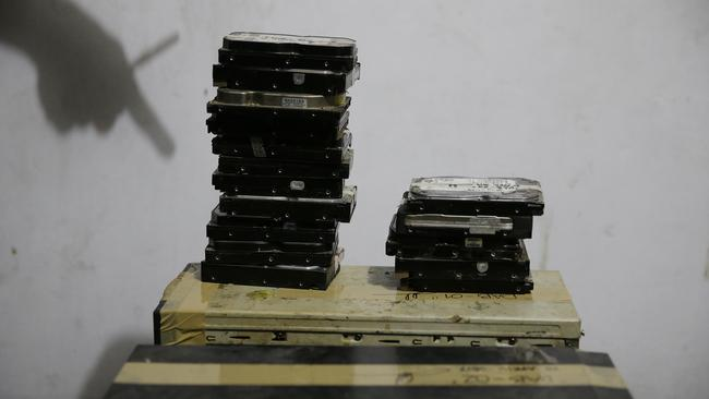 Computer hard drives gathered at the scene. Picture: AP/Aaron Favila
