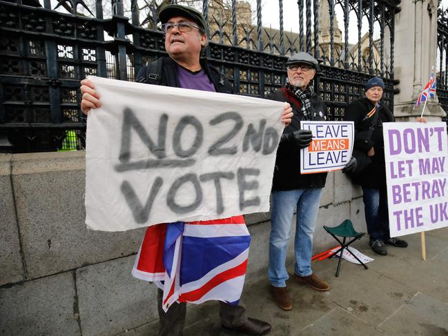 A protester against a second EU referendum protests outside the Houses of Parliament in central London. Picture: Supplied