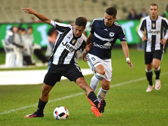 Juventus' Paulo Dybala (L) and Melbourne Victory's Daniel Gerogievski.