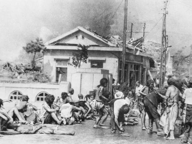 A Hiroshima Street scene at 10am in the morning on the day the Atomic Bomb was dropped, showing injured civilian survivors on Miyuki Bridge with smoke and fires in the background. Picture: Yoshito Matsushige