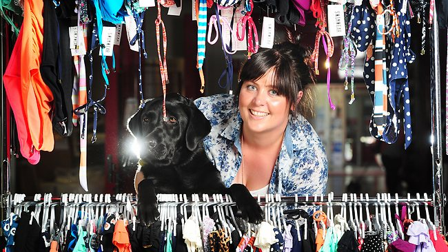 Kirby Squillari, finished Artist at Cotton On Geelong with dog Travis. Picture: Mitch Bear