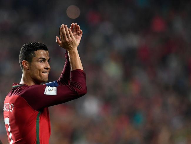 Portugal's midfielder Cristiano Ronaldo applauds