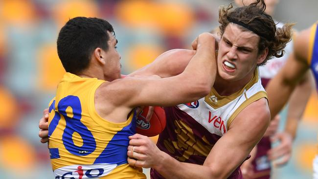 Eagle Thomas Cole can't quite shake free from the clutches of Brisbane's Jarrod Berry. Picture: AAP