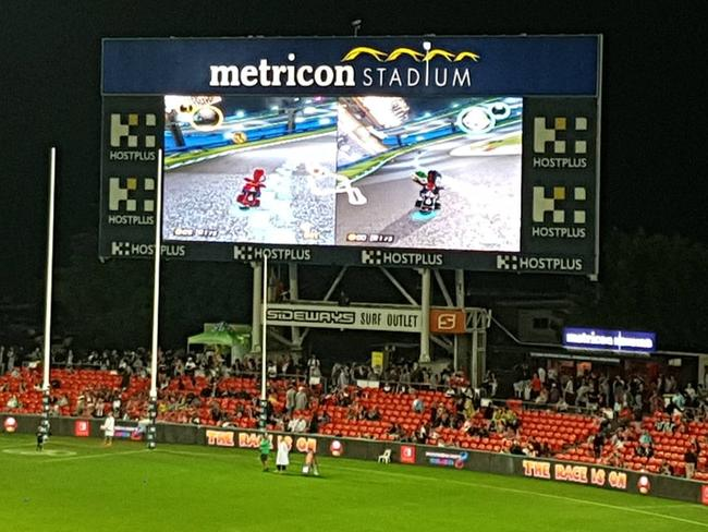 A photo of the halftime entertainment at Metricon Stadium - Mario Kart. Supplied via Reddit user dippa_.