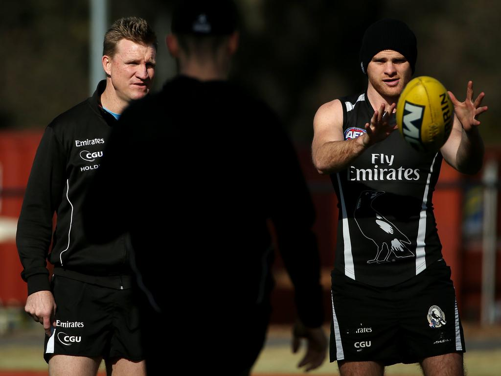 Nathan Buckley chats with Heath Shaw during their time together at Collingwood.
