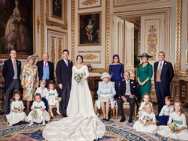 Princess Eugenie and Jack Brooksbank in an official wedding photograph with Tom Brooksbank, Nicola Brooksbank, George Brooksbank, Princess Beatrice, Sarah Ferguson, Prince Andrew, Prince George, Princess Charlotte, The Queen, Prince Philip, Maud Windsor, Louis De Givenchy, Theodora Williams, Mia Tindall, Isla Phillips, Savannah Phillips. Picture: Alex Bramall