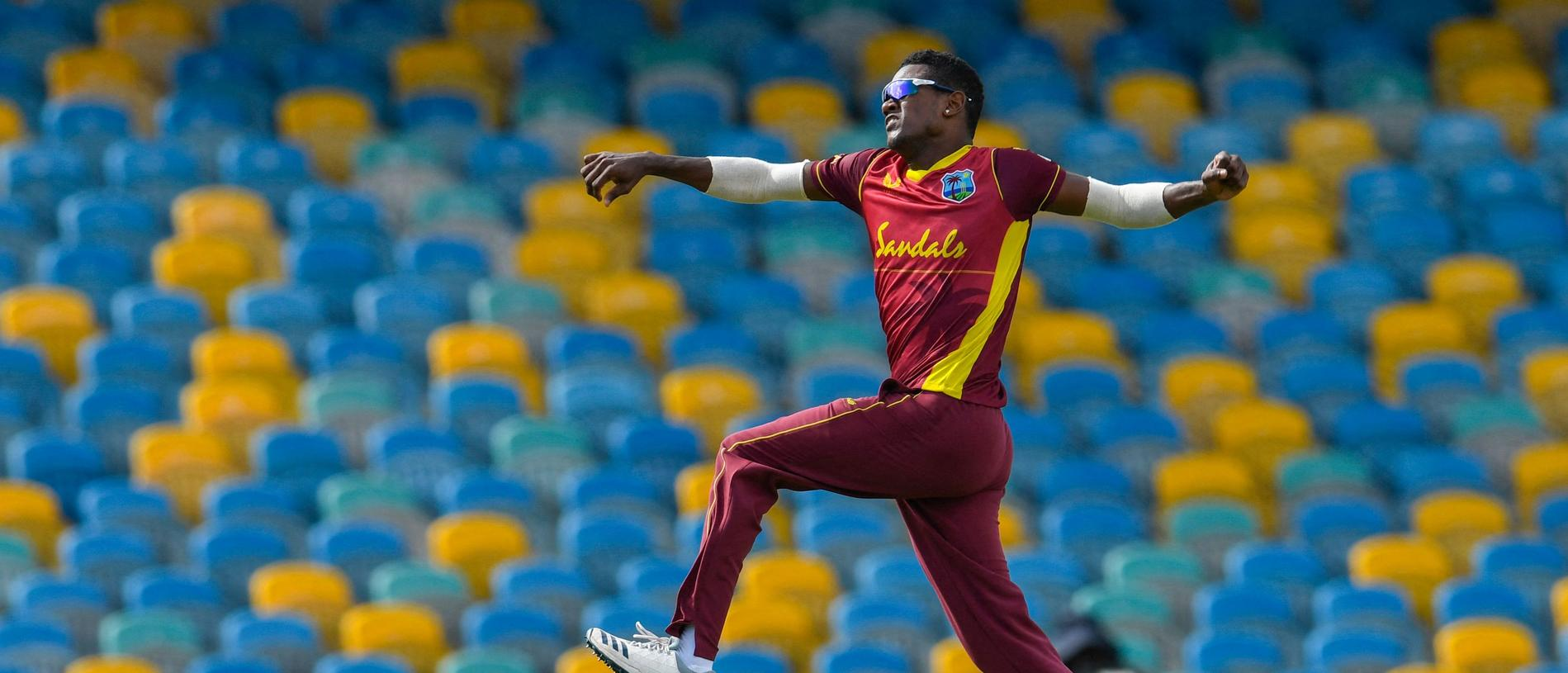 Akeal Hosein of the West Indies celebrates the dismissal of Alex Carey of Australia during the 2nd ODI between West Indies and Australia at Kensington Oval, Bridgetown, Barbados, on July 24, 2021. (Photo by Randy Brooks / AFP)