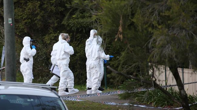 Forensic officer at the scene of a double shooting in West Pennant Hills in July. Picture: John Grainger