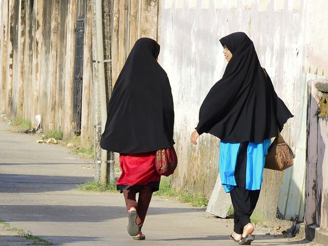 Sri Lankan Muslim girls walk along a road in Kattankudy days after the deadly attack. Picture: Lakruwan Wanniarachchi