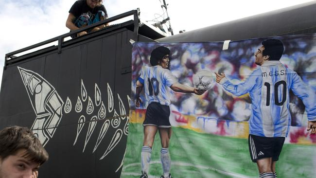A banner featuring player Lionel Messi, right, and former player Diego Maradon.