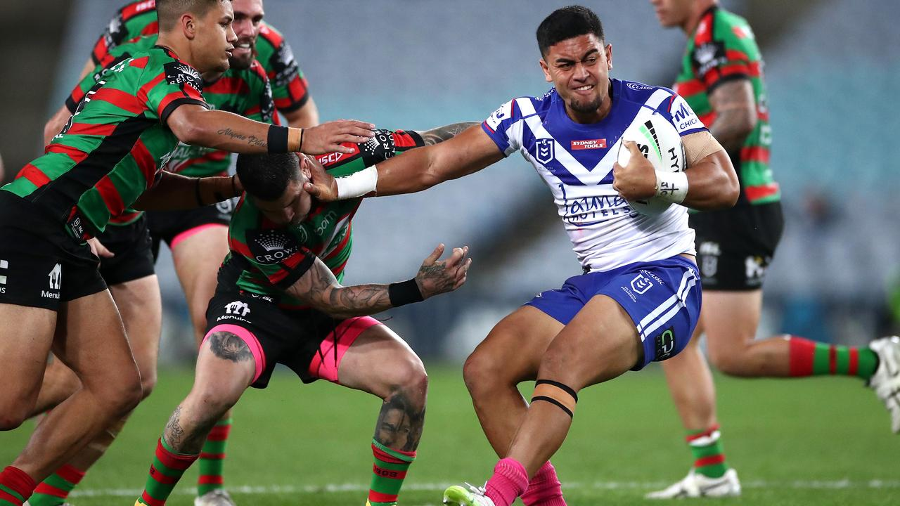 Tim Lafai fends off the Rabbitohs' defence