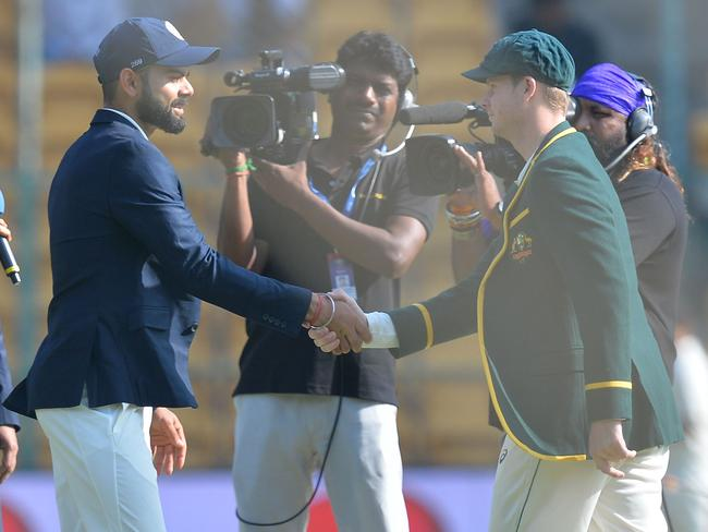 Virat Kohli shakes hands with Steve Smith before an explosive second Test.