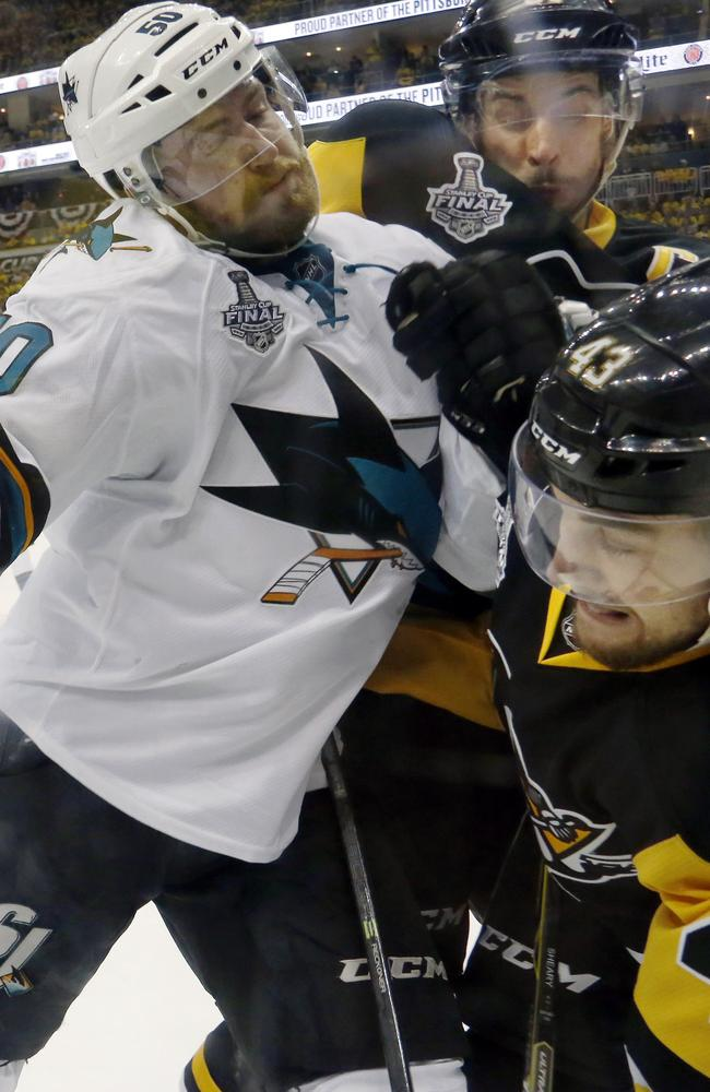San Jose Sharks' Chris Tierney collides with Pittsburgh Penguins' Sidney Crosby and Conor Sheary.