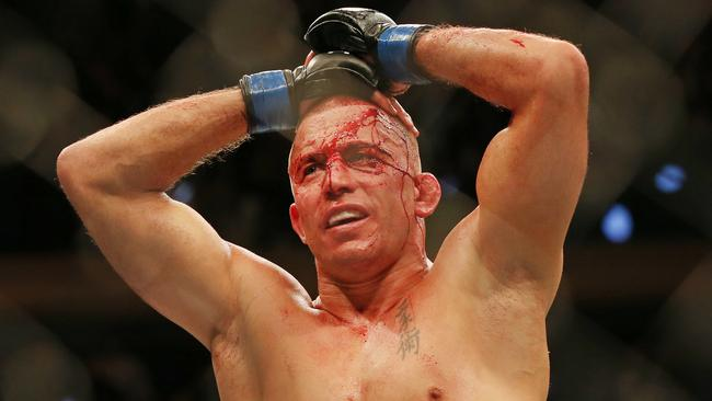 George St. Pierre after choking out Michael Bisping at UFC 217. Picture: Richard Dobson