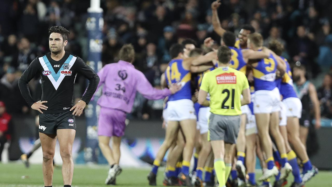 Chad Wingard stands in disbelief as the Eagles players celebrate after the siren. Photo: Sarah Reed