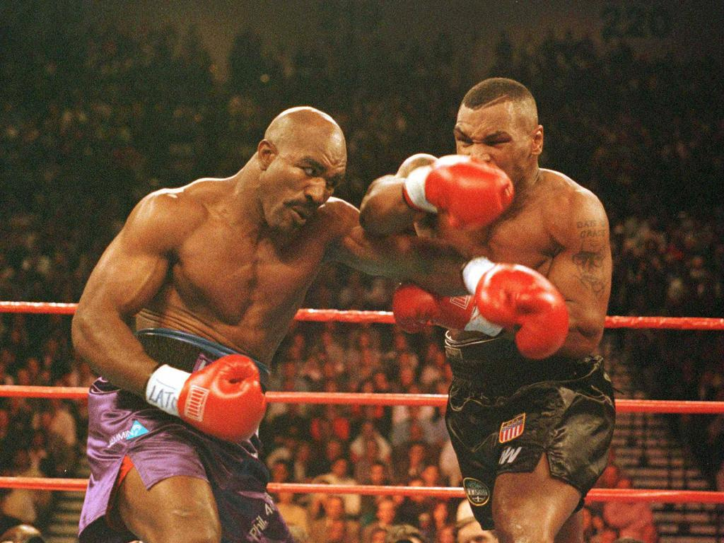 Tyson and Holyfield slug it out in their first match.
