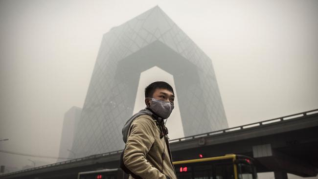 You'd probably support climate action too if you lived in smog this thick. Picture: Kevin Frayer/Getty Images